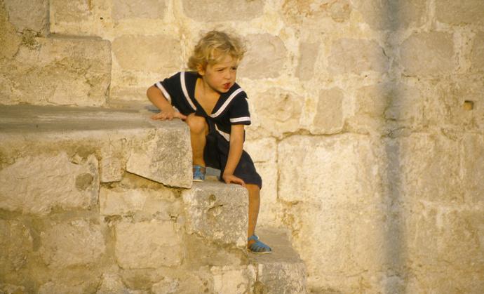 Boy on City Wall